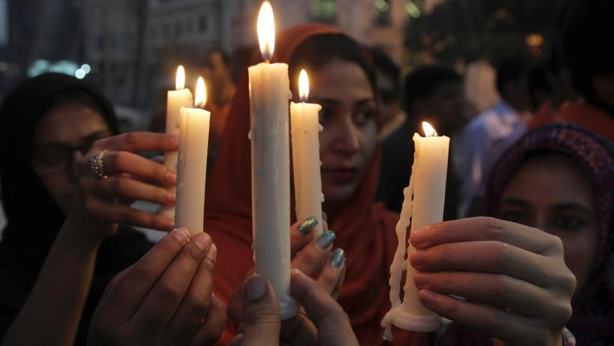 People attend a candlelight vigil for the victims of an overnight attack on the Quetta Police Training Academy, in Lahore, Pakistan, Tuesday, Oct. 25, 2016. Militants wearing suicide vests stormed a Pakistani police academy in the southwestern city of Quetta overnight, killing dozens of people, mostly police cadets and recruits, and waging a ferocious gun battle with troops that lasted into early hours Tuesday. (AP Photo/K.M. Chaudary)