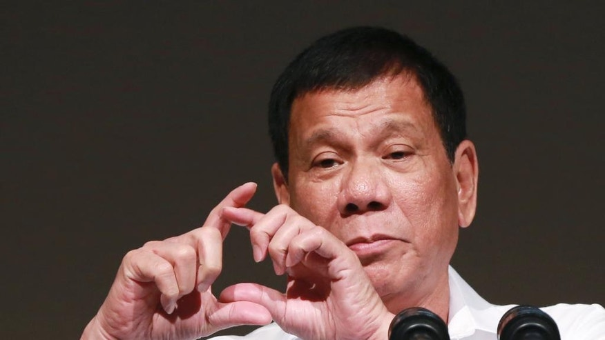 Philippine President Rodrigo Duterte delivers a speech at the Philippine Economic Forum in Tokyo, Wednesday, Oct. 26, 2016. Duterte is on a three-day official visit to Japan. (AP Photo/Eugene Hoshiko)