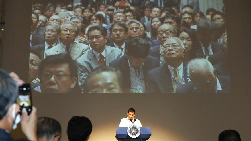 Philippine President Rodrigo Duterte addresses a speech at the Philippine Economic Forum in Tokyo, Wednesday, Oct. 26, 2016. President Duterte is on a three-day official visit to Japan, his first as Philippine leader. (AP Photo/Eugene Hoshiko)