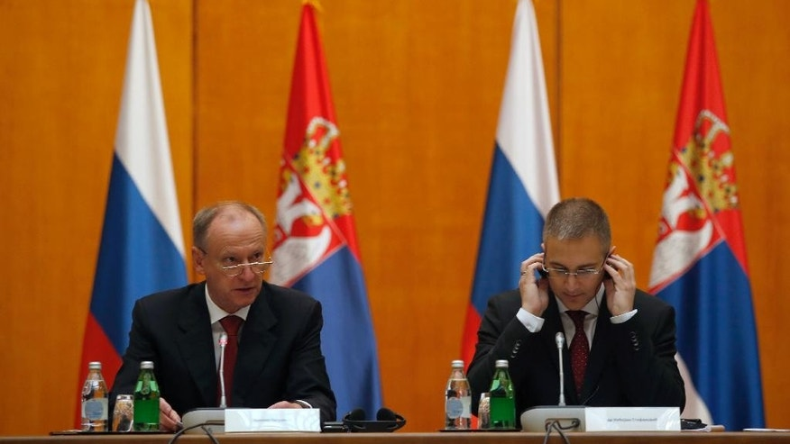 Serbian Interior Minister Nebojsa Stefanovic, right, listens Russian Security Council Secretary Nikolai Patrushev, left, during a meeting at the Serbia Palace, in Belgrade, Serbia, Wednesday, Oct. 26, 2016. Russia's top security official is urging closer cooperation with Serbia as part of increased efforts by Moscow to step up its influence the traditional Balkan ally seeking European Union membership. (AP Photo/Darko Vojinovic)