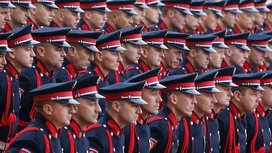 Members of Serbian police honor guard line-up in front of a red carpet set for a welcome ceremony for visiting Russian Security Council Secretary Nikolai Patrushev outside the Serbia Palace, in Belgrade, Serbia, Wednesday, Oct. 26, 2016. Russia's top security official is urging closer cooperation with Serbia as part of increased efforts by Moscow to step up its influence the traditional Balkan ally seeking European Union membership. (AP Photo/Darko Vojinovic)