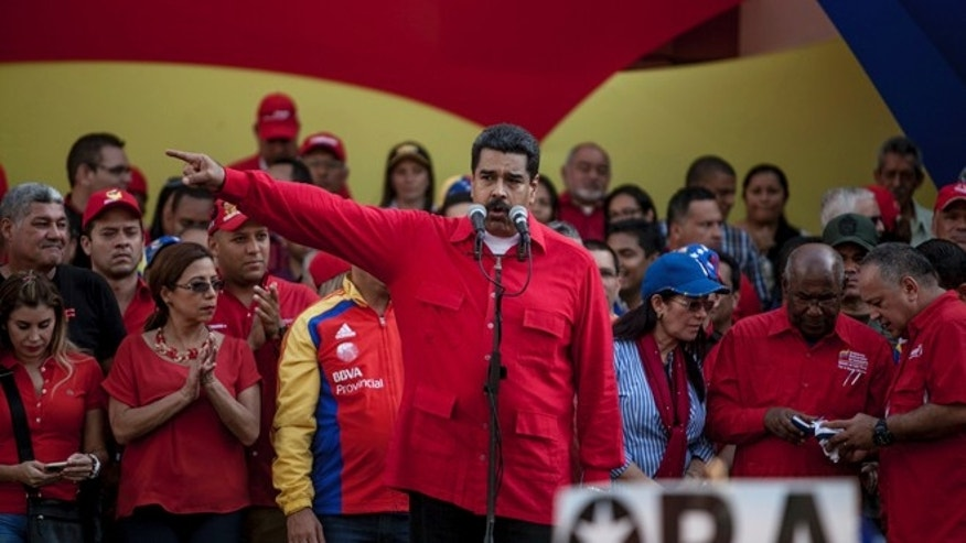 "Venezuela's President Nicolas Maduro speaks during a political rally against the opposition-controlled congress, in Caracas, Venezuela, Tuesday, Oct. 25, 2016. After the government suspended a recall referendum seeking Maduro's removal last week, the congress began debating his ""constitutional situation."" Lawmakers vow to present evidence that Maduro is a dual Colombian citizen and therefore constitutionally ineligible to hold Venezuela's highest office. (AP Photo/Alejandro Cegarra)"