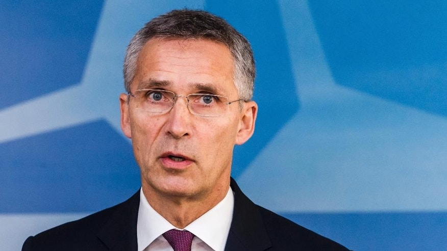 CORRECTS NAME - NATO Secretary General, Jens Stoltenberg, addresses the media at the start of a meeting of the North Atlantic Council Defence Ministers session at NATO headquarters in Brussels, Wednesday, Oct. 26, 2016. NATO defence ministers are meeting in Brussels to discuss tense relations with Russia, how to help Middle East nations combat extremism and cooperation between the military alliance and the European Union. (AP Photo/Geert Vanden Wijngaert)