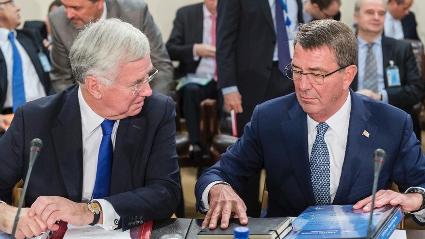 U.S. Secretary of Defense Ash Carter, right, talks with Britain's Secretary for Defense Michael Fallon during a meeting of the North Atlantic Council in Defense Ministers session at NATO headquarters in Brussels on Wednesday, Oct. 26, 2016. NATO defense ministers meet in Brussels to discuss tense relations with Russia, how to help Middle East nations combat extremism and cooperation between the military alliance and the European Union.(AP Photo/Geert Vanden Wijngaert)