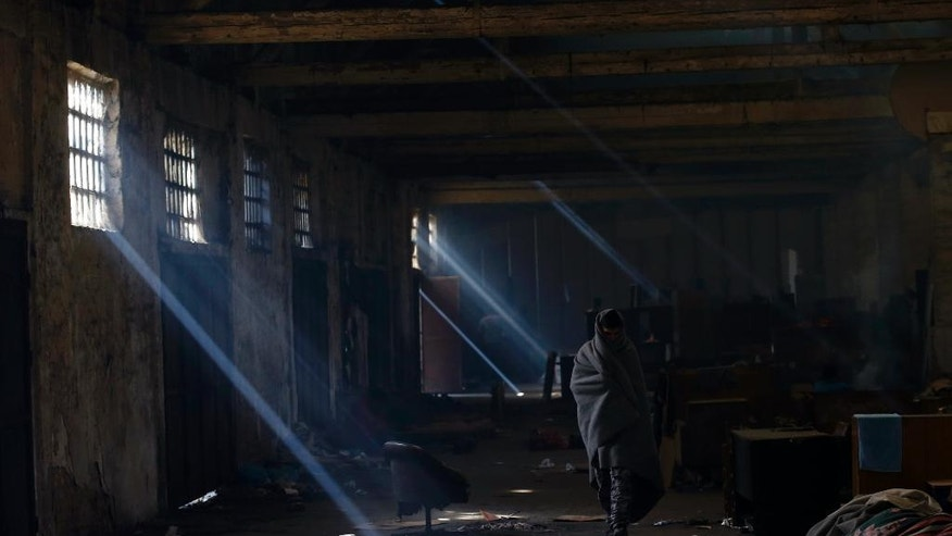 A migrant walks inside an abandoned warehouse in Belgrade, Serbia, Thursday, Oct. 27, 2016. More than 200 migrants have turned a former warehouse in central Belgrade into their temporary home. Several thousand migrants are stuck in Serbia looking for ways to cross into the European Union using clandestine routes and the help of people smugglers. (AP Photo/Darko Vojinovic)