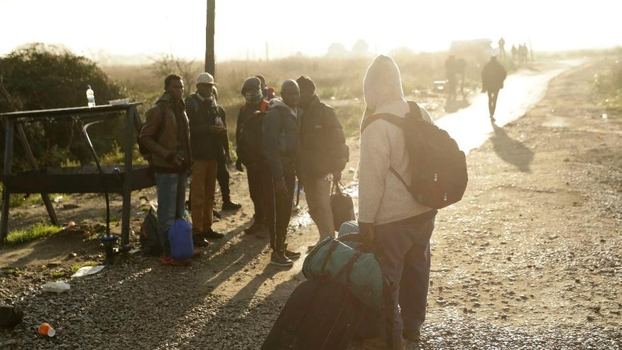 "Migrants walk round the outskirts of the makeshift migrant camp known as ""the jungle"" near Calais, northern France, Thursday, Oct. 27, 2016. Some migrants were left stranded as the processing center was closed after French authorities claimed on Wednesday that they had cleared the makeshift migrant camp near the northern French city of Calais. (AP Photo/Matt Dunham)"
