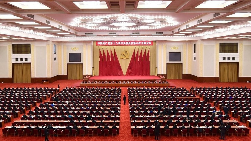 "In this photo released by Xinhua News Agency, Chinese leaders attend the Sixth Plenary Session of the 18th CPC Central Committee held in Beijing on Thursday, Oct 27, 2016. China's Communist Party has elevated President Xi Jinping to the position of ""core"" of the leadership, underscoring the overwhelming clout he has amassed on the back of a sweeping anti-corruption campaign and crackdown on dissent. (Zhang Duo/Xinhua via AP)"