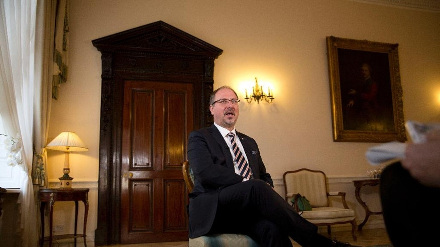 """Polish ambassador to Britain Arkady Rzegocki speaks during an interview with The Associated Press at the Polish Embassy in London, Wednesday, Oct. 12, 2016. Ambassador Rzegocki, said he was """"shocked and deeply concerned"""" by the hostility toward a community whose presence in Britain goes back to World War II, when Polish pilots fought in the Battle of Britain and a Polish government-in-exile was based in London. """"The hospitality of British society was very famous, and we appreciate it,"""" he said. (AP Photo/Matt Dunham)"""