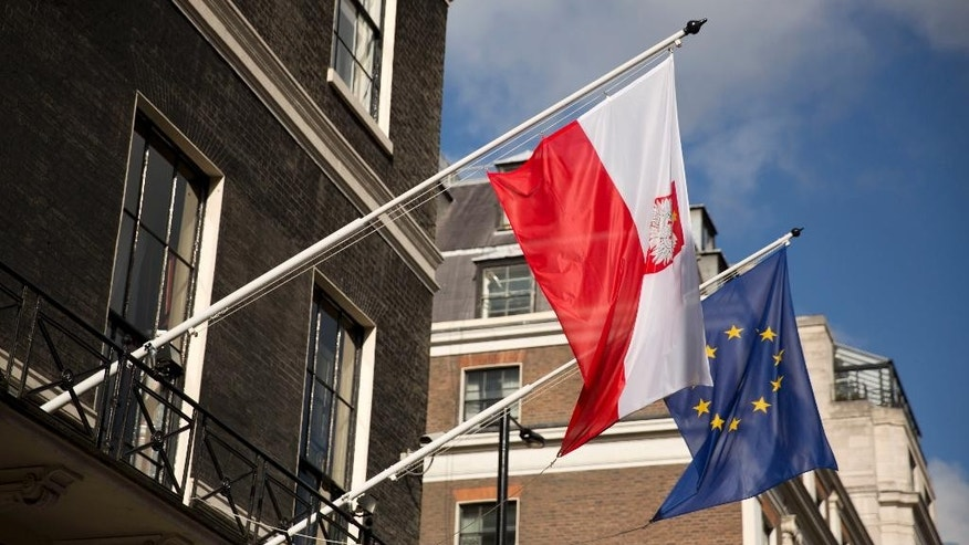 "A Polish and EU flag fly outside the Polish Embassy in London, Wednesday, Oct. 12, 2016. Polish ambassador to Britain Arkady Rzegocki has said he was ""shocked and deeply concerned"" by the hostility toward a community whose presence in Britain goes back to World War II, when Polish pilots fought in the Battle of Britain and a Polish government-in-exile was based in London. ""The hospitality of British society was very famous, and we appreciate it,"" he said. (AP Photo/Matt Dunham)"