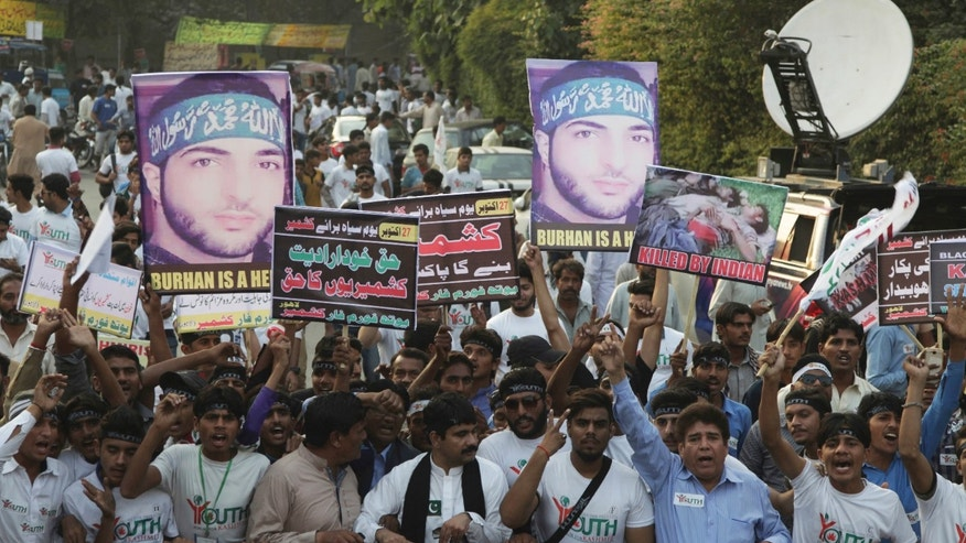 People rally against India to express solidarity with Indian Kashmiris fighting against government forces, in Lahore, Pakistan, Thursday. Pakistan's Foreign Ministry on Thursday said India was expelling a Pakistani diplomat in New Delhi.