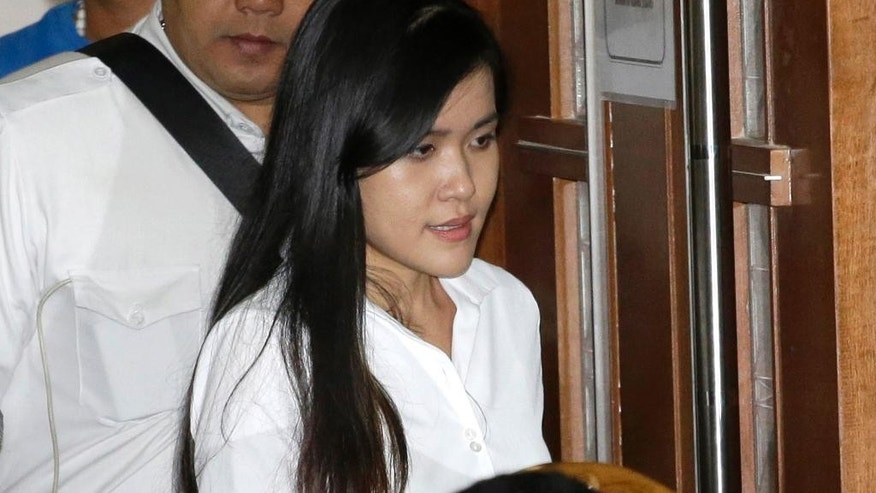 Jessica Kumala Wongso enters a courtroom prior to the start of her sentencing hearing at Central Jakarta District Court in Jakarta, Indonesia, Thursday, Oct. 27, 2016. The former Australian resident is accused of killing her friend Wayan Mirna Salihin with a cyanide-laced coffee to 20 years in prison in a dramatic climax to a trial that was broadcast live and became a national spectacle. (AP Photo/Tatan Syuflana)