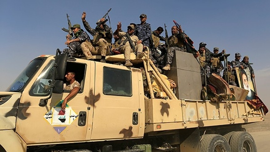 Iraqi forces regain IS-controlled town in road to Mosul - statement
