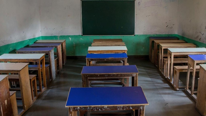 In this Tuesday, Oct. 18, 2016 photo, desks and benches stand in a row inside an empty classroom of a private school that has remained closed for the past three months in Srinagar, Indian controlled Kashmir. With daily life still paralyzed by strikes and rolling curfews, dozens of ad-hoc learning centers have popped up in people's homes or religious centers like mosques in Kashmir since August. The centers are doing more than just helping students prepare for upcoming exams, organizers said. They're keeping kids off the streets and giving them comfort amid a civilian uprising sparked when a popular rebel leader was killed in fighting Indian forces on July 8. (AP Photo/Dar Yasin)