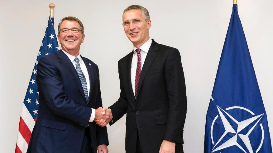 NATO Secretary General Jens Stoltenberg, right, greets U.S Secretary of Defense Ash Carter prior to a meeting of the North Atlantic Council in Defense Ministers session at NATO headquarters in Brussels on Wednesday, Oct. 26, 2016. NATO defense ministers met in Brussels to discuss tense relations with Russia, how to help Middle East nations combat extremism and cooperation between the military alliance and the European Union.(AP Photo/Geert Vanden Wijngaert, pool)
