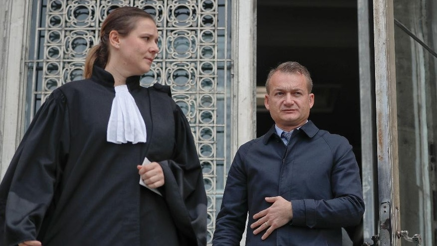 Adrian Coman, right, exits the Constitutional Court along with his lawyer Iustina Ionescu, in Bucharest, Romania, Thursday, Oct. 27, 2016. Coman is asking the Constitutional Court to recognize his 2010 marriage in Belgium to a U.S. citizen Claibourn Robert Hamilton, in a case that has pitted a conservative majority against those who seek closer integration into the European mainstream. (AP Photo/Vadim Ghirda)