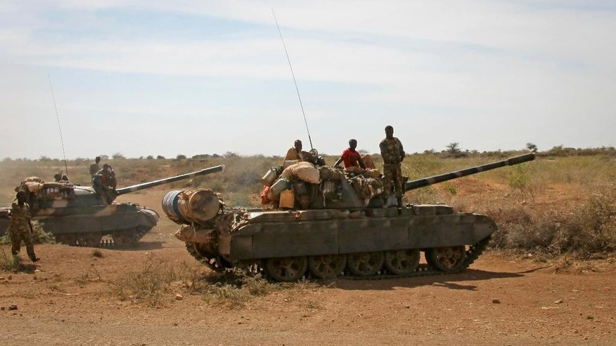 FILE - In this Wednesday, Feb. 29, 2012 file photo, Ethiopian military tanks sit in position on the outskirts of the town of Baidoa in Somalia. In Oct. 2016 Ethiopia - which has 2,000 troops in the African Union force and an unknown number operating independently in Somalia - pulled its forces out of four towns in Somalia and within hours al-Shabab fighters had seized control. Somalia's Islamic extremist rebels, al-Shabab, are making a comeback, having recently seized four towns and attacked a guesthouse in neighboring Kenya, killing 12. (AP Photo, File)