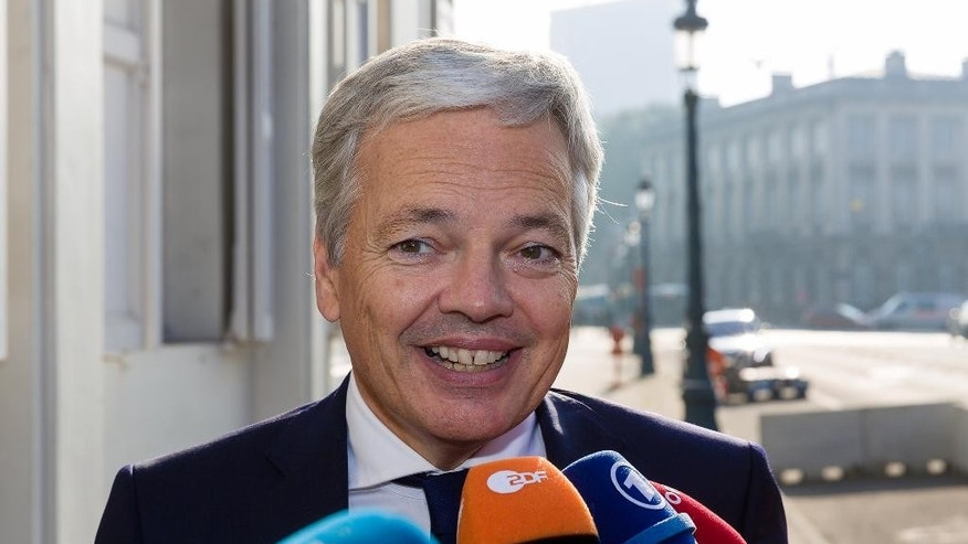 Belgium Minister of Foreign Affairs, Didier Reynders, speaks with the media during a break in a meeting at the Belgium Prime Minister's residence in Brussels, Wednesday, Oct. 26, 2016. Belgium is stretching talks to convince its region of Wallonia to give the necessary backing to a trade deal between the European Union and Canada into the eve of a summit to sign the landmark agreement. (AP Photo/Thierry Monasse)