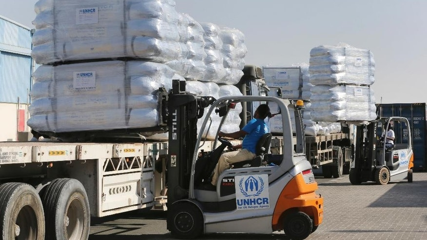 Lift truck drivers upload family tents for the Mosul refugees at the UNHCR warehouses, part of the International Humanitarian City (IHC) in Dubai, United Arab Emirates, Thursday, Oct. 27, 2016. The United Nations' refugee agency is shipping tents, blankets and other aid from the United Arab Emirates to northern Iraq to help those affected by the U.S.-led push to retake Mosul from the Islamic State group. (AP Photo/Kamran Jebreili)