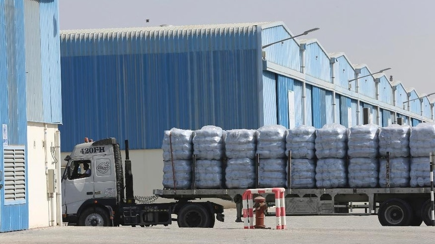 A truck with family tents for the Mosul refugees leaves the UNHCR warehouses, part of the International Humanitarian City (IHC) in Dubai, United Arab Emirates, Thursday, Oct. 27, 2016. The United Nations' refugee agency is shipping tents, blankets and other aid from the United Arab Emirates to northern Iraq to help those affected by the U.S.-led push to retake Mosul from the Islamic State group. (AP Photo/Kamran Jebreili)