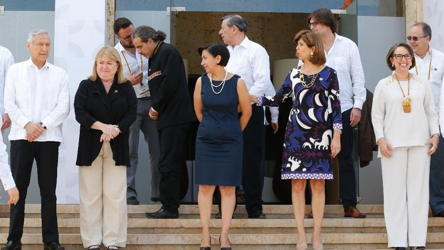 Colombia's Foreign Minister Maria Angela Holguin, second from right, and foreign government representatives arrive for a group photo during the 25th Ibero-American Summit in Cartagena, Colombia, Friday, Oct. 28, 2016. The Ibero-American Summit is an annual meeting of heads of state from Latin America and the Iberian Peninsula. (AP Photo/Fernando Vergara)