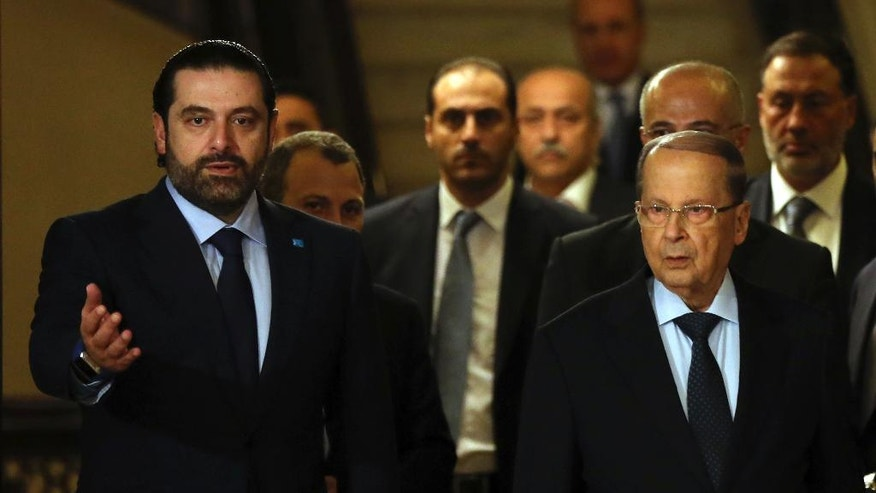 In this picture taken on Thursday, Oct. 20, 2016, former Lebanese Prime Minister Saad Hariri, left, welcomes Christian leader Michel Aoun, right, after he announced to support Aoun to Lebanese president, in Beirut, Lebanon. Michel Aoun, an 81-year-old veteran Christian leader, is set to be elected by Parliament on Monday as part of a political deal that's expected to be another boost for President Bashar Assad in neighboring Syria. (AP Photo/Hussein Malla)