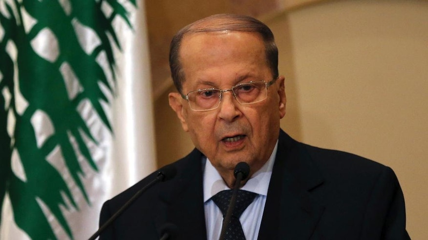 FILE -- In this Thursday, Oct. 20, 2016, file photo, Christian leader Michel Aoun, speaks to journalists after former Lebanese Prime Minister Saad Hariri announced to support him to be Lebanese president, in Beirut, Lebanon, Thursday, Oct. 20, 2016. Michel Aoun, an 81-year-old veteran Christian leader, is set to be elected by Parliament on Monday as part of a political deal that's expected to be another boost for President Bashar Assad in neighboring Syria. (AP Photo/Hussein Malla, File)
