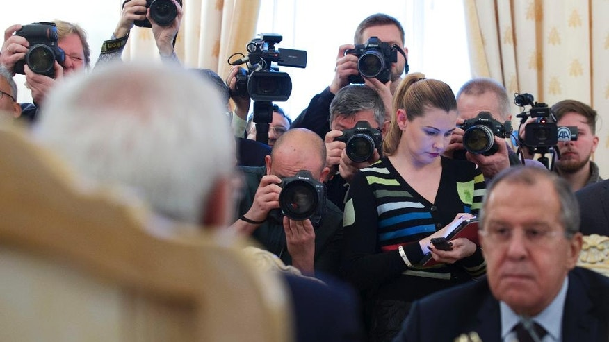 Media crowd filming a meeting between Russian Foreign Minister Sergey Lavrov, bottom right, and his Iranian counterpart Mohammad Javad Zarif in Moscow, Russia, on Friday, Oct. 28, 2016. (AP Photo/Ivan Sekretarev)