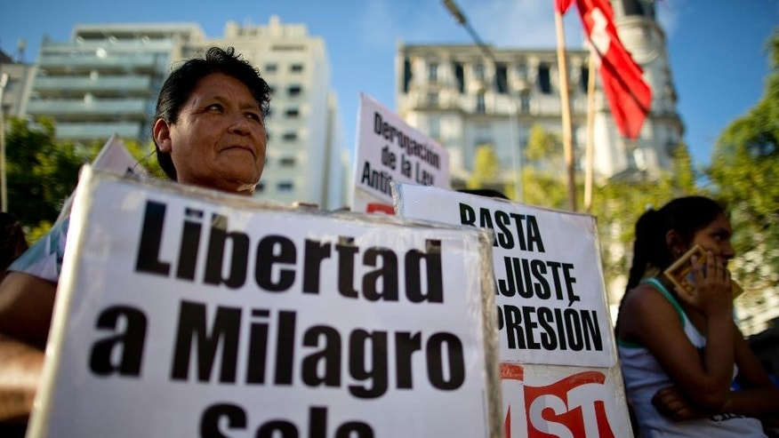 """FILE- In this Jan. 27, 2016 file photo, a woman holds a banner that reads in Spanish; """"Free Milagro Sala,"""" during a demonstration in support of Argentina's Tupac Amaru social movement leader Milagro Sala, in Buenos Aires, Argentina. A United Nations panel says Argentina has arbitrarily detained Sala and is asking the government for her immediate release. The resolution was announced Friday, Oct. 28, 2016.  (AP Photo/Natacha Pisarenko, File)"""
