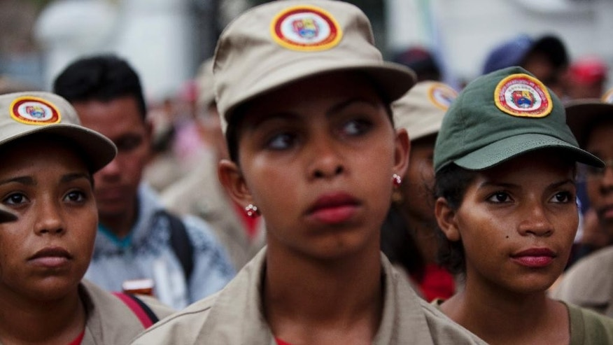 Women members of the Bolivariana militia gather during a march to support Venezuela's President Nicolas Maduro, outside Miraflores presidential palace in Caracas, Venezuela, Thursday, Oct. 27, 2016. Electoral authorities blocked a recall campaign against Maduro last week, and a face-off with congress escalated on Tuesday when the legislature voted to put Maduro on trial, accusing him of effectively staging a coup. (AP Photo/Rodrigo Abd)