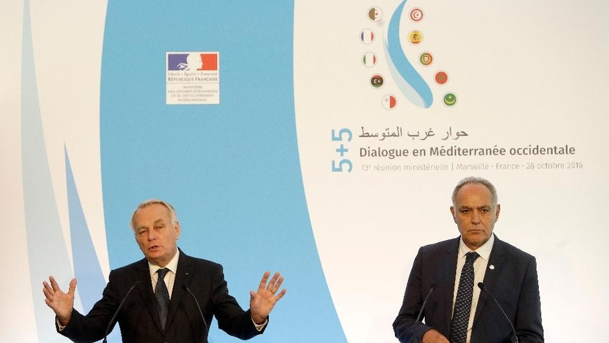France's Foreign Minister Jean-Marc Ayrault , left, accompanied by Morocco's Foreign Minister Salaheddine Mezouar, gestures as he speaks with medias during a press conference at the end of the Mediterranean Summit , at the Villa Mediterranee in Marseille, southern France, Friday, Oct. 28, 2016. France is hosting an international summit of foreign ministers from countries near the western Mediterranean Sea that is expected to discuss the fight against the Islamic State group in Syria along with other topics of mutual interest. (AP Photo/Claude Paris)