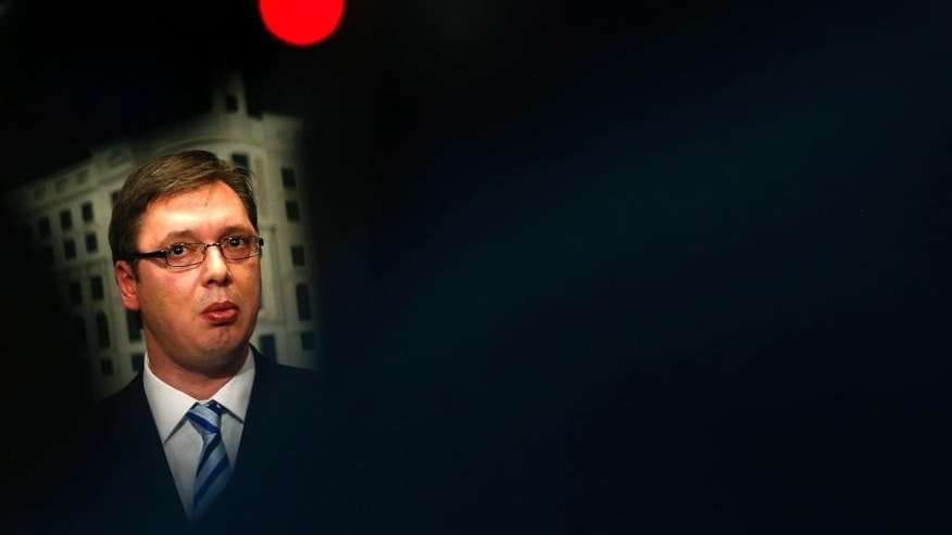 FILE- In this Friday, June 19, 2015 file photo, Serbia's Prime Minister Aleksandar Vucic during a press conference in Belgrade, Serbia.  Serbia's  interior minister Nebojsa Stefanovic said Vucic has been moved to a safe location after a large of cache of weapons including anti-tank rocket, hand grenades and sniper rifle ammunition was found Saturday Oct. 29, 2016, near his family home near Belgrade. (AP Photo/Darko Vojinovic, FILE)