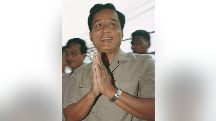 FILE - In this April 23, 1997 file photo, Pen Sovann arrives at a news conference in Phnom Penh.  Former Cambodian Prime Minister Pen Sovann, who was installed then imprisoned by the Vietnamese after they defeated the brutal Khmer Rouge regime, has died. He was 80. Pen Sovann was the country's first post-Khmer Rouge prime minister, holding the office from June to December 1981, when it was known as the People's Republic of Kampuchea. He died Saturday night, Oct. 29, 2016, from an illness in his hometown in southern Takeo province. (AP Photo/Charles Dharapak, File)