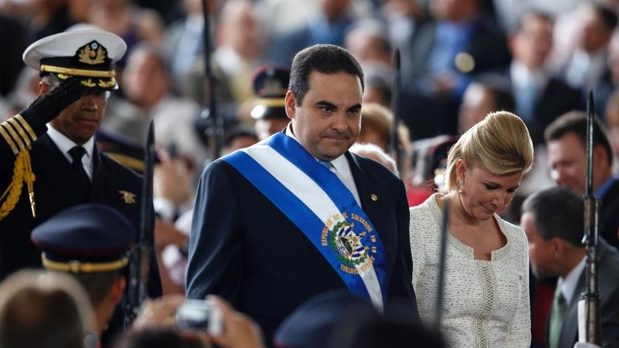 FILE - In this  June 1, 2009, file photo, on his last day as President of El Salvador, Tony Saca and his wife, Ana Ligia de Saca, arrive at the inauguration ceremony of the new president of El Salvador Mauricio Funes in San Salvador. Prosecutors said Saturday, Oct. 29, 2016, that Ex-President Saca has been arrested for alleged illicit enrichment, unlawful association and money laundering. (AP Photo/Dario Lopez-Mills, File)