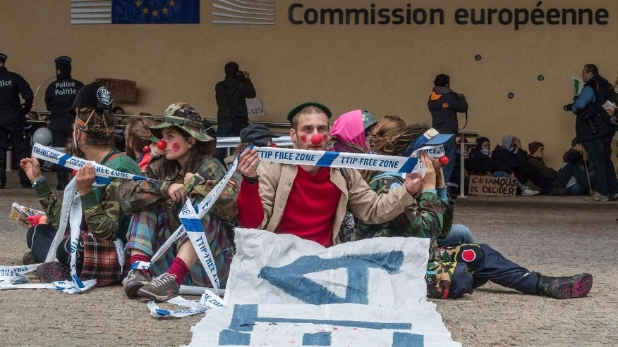 Demonstrators dressed as clowns protest against international trade agreements TTIP and CETA in front of EU headquarters in Brussels on Thursday, Oct. 27, 2016. The Belgian government has reached a deal to back a free trade deal between the European Union and Canada on the day the agreement was supposed to be officially signed with Canadian Prime Minister Justin Trudeau(AP Photo/Geert Vanden Wijngaert)