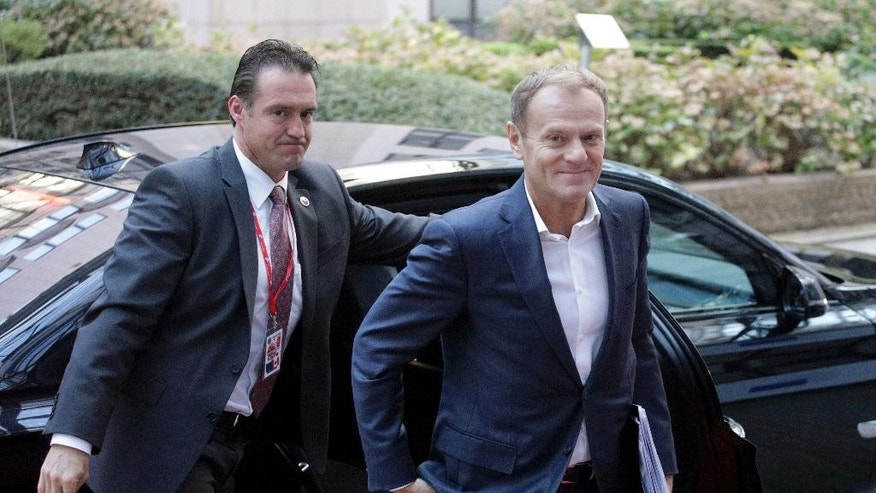 European Council President Donald Tusk, right, arrives for an EU-Canada summit at the European Council building in Brussels, Sunday, Oct. 30, 2016. Canadian and EU officials, in a one-day summit, are to sign the Comprehensive Economic and Trade Agreement (CETA). (AP Photo/Olivier Matthys)