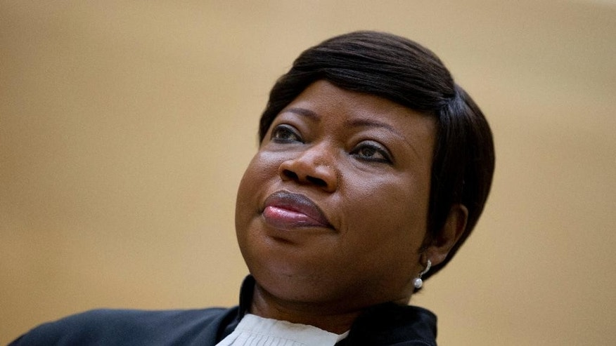 FILE - In this Tuesday, Sept. 29, 2015 file photo, prosecutor Fatou Bensouda waits for former Congo vice president Jean-Pierre Bemba to enter the court room of the International Criminal Court in The Hague, Netherlands. The International Criminal Court, which this year moved into a new headquarters in The Hague, has long been accused by some African leaders of bias against their continent. The court's chief prosecutor, Fatou Bensouda, herself a Gambian, was defiant this week and insisted _ as do other observers _ that the court will weather the current crisis. (AP Photo/Peter Dejong, file)