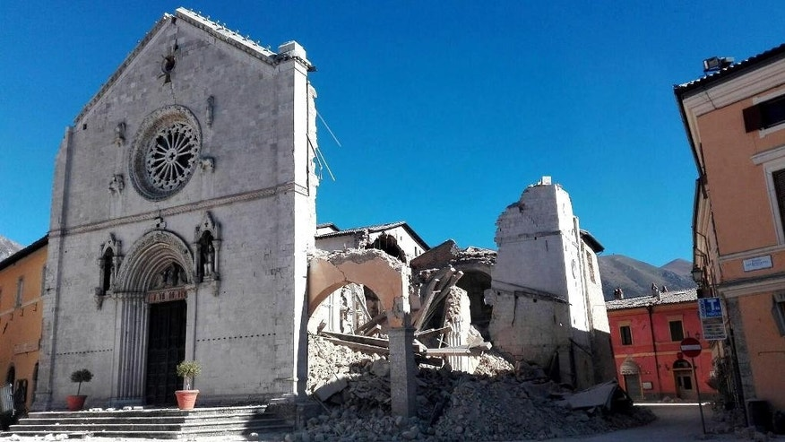A view of the facade of the San Benedetto Basilica, in Norcia, central Italy, after an earthquake with a preliminary magnitude of 6.6 struck central Italy, Sunday, Oct. 30, 2016. A powerful earthquake rocked the same area of central and southern Italy hit by quake in August and a pair of aftershocks last week, sending already quake-damaged buildings crumbling after a week of temblors that have left thousands homeless. (Matteo Guidelli/ANSA via AP))