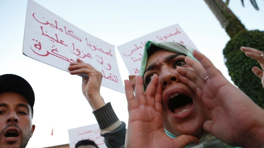 "A Moroccan shouts as thousands of Moroccans protest against the death of Mouhcine Fikri last Friday,  with placard reading ""mash us of respect us"", in the northern city of Hoceima in Rabat, Morocco, Sunday, Oct. 30, 2016.  Crowds of Moroccans are protesting, seemingly incensed by the death of a fisherman crushed to death in a garbage truck. (AP Photo/Abdeljalil Bounhar)"