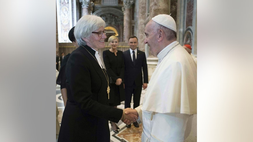 FILE -- In this file photo, taken on June 5, 2016, Pope Francis meets Lutheran Archbishop Antje Jackelen, Primate of the Church of Sweden, on the occasion of the canonization ceremony of two new Saints, Stanislaus of Jesus and Maria Elizabeth Hesselblad, at the Vatican. Pope Francis travels to Sweden next week to commemorate the split in Western Christianity 500 years ago. (L'Osservatore Romano/Pool Photo via AP)