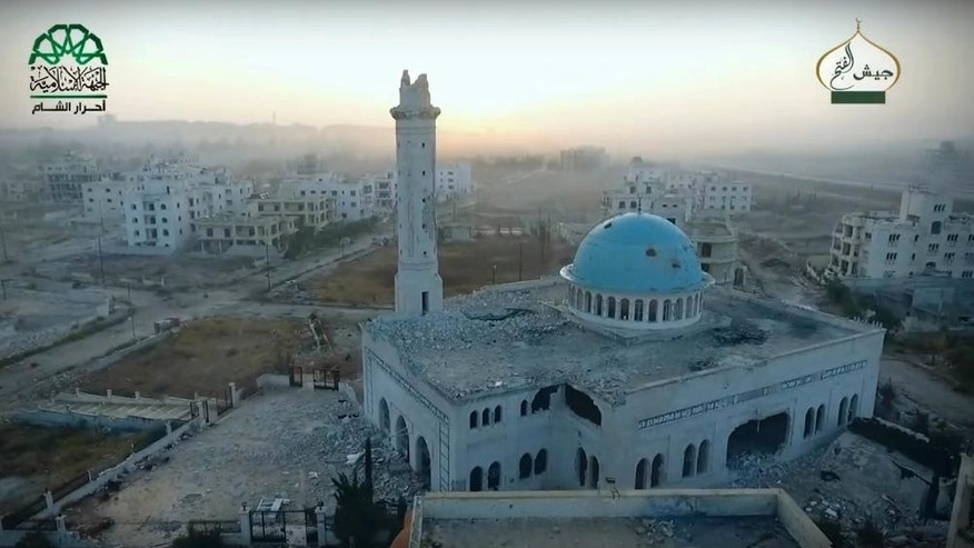 This still image taken from undated drone footage, posted online by the communications arm of Ahrar al-Sham militant group, purports to show a damaged mosque in an Assad neighborhood of Aleppo, Syria. Syrian government forces launched a counteroffensive Saturday, Oct. 29, 2016, under the cover of airstrikes in an attempt to regain control of areas they had lost to insurgents the day before in the northern city of Aleppo, activists and state media said. (Ahrar al-Sham, militant video, via AP)
