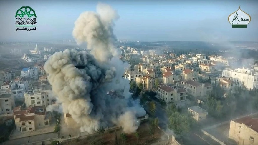 This still image taken from drone footage, posted online by the communications arm of Ahrar al-Sham militant group, purports to show a blast on the ground, apparently the result of an airstrike, in a Syrian-government controlled neighborhood of Aleppo, Syria. Syrian government forces launched a counteroffensive Saturday, Oct. 29, 2016, under the cover of airstrikes in an attempt to regain control of areas they had lost to insurgents the day before in the northern city of Aleppo, activists and state media said. (Ahrar al-Sham, militant video, via AP)