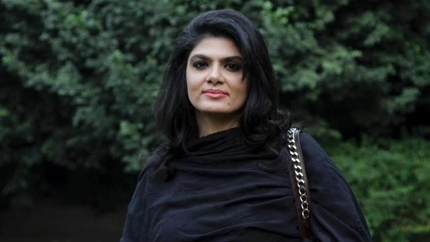 "In this Oct. 21, 2016 photo, Sughra Imam, a member of the Pakistani Parliament's upper house talks to The Associated Press about a historic law to protect women from murder by members of their own families, that was passed by the Parliament, in Lahore, Pakistan. Two women, Naeema Kishwar, whose political party is often linked to the Taliban and Harvard-educated Imam, came together in an extraordinary moment in Pakistan's history to pass a bill to remove ""honor"" from killing. Neither woman got exactly what she wanted but the compromise bill that finally passed makes sure those who kill in the name of ""honor"" are punished. (AP Photo/K.M.Chaudary)"