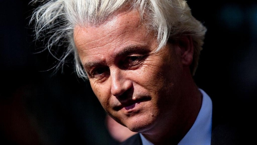 In this May 12, 2014 file photo Dutch lawmaker Geert Wilders pauses, as he speaks to journalists outside the Dutch National Bank in Amsterdam. The politically charged hate speech trial of Dutch firebrand anti-Islam lawmaker Geert Wilders is set to start, with Wilders himself boycotting the opening, at the extra secure court building at Schiphol airport near Amsterdam, Netherlands, Monday, Oct. 31, 2016. (AP Photo/Peter Dejong)