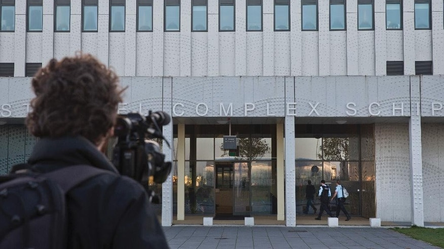 A cameraman films the extra secure court building at Schiphol airport where the politically charged hate speech trial of Dutch firebrand anti-Islam lawmaker Geert Wilders is set to start, with Wilders himself boycotting the opening, near Amsterdam, Netherlands, Monday, Oct. 31, 2016. (AP Photo/Peter Dejong)
