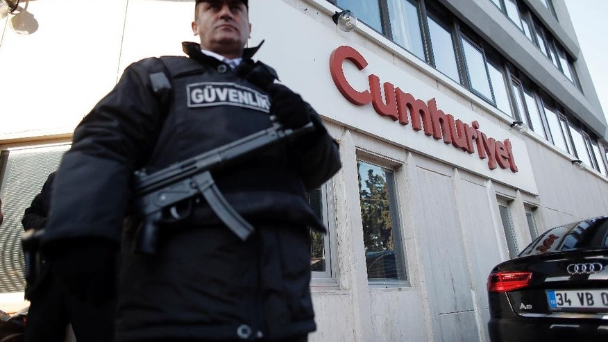 A security guard stands outside Cumhuriyet's Istanbul headquarters after police detained chief editor Murat Sabuncu and two columnists of Turkey's opposition Cumhuriyet newspaper and had warrants to detain 10 other senior staff members, in Istanbul, Monday, Oct. 31, 2016, the state-run-Anadolu Agency reported, amid growing fears over Turkey's widening crackdown on dissenting voices. (AP Photo/Emrah Gurel)