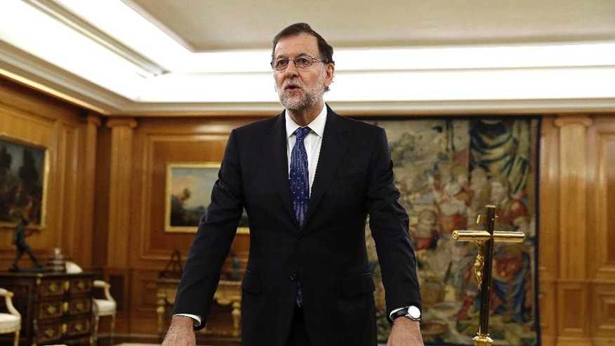 Mariano Rajoy takes the oath as Prime Minister at the Zarzuela Palace in Madrid, Spain Monday Oct. 31, 2016. Spain's Parliament voted to approve acting Prime Minister Mariano Rajoy's bid to form a new minority government last Saturday putting an end to the country's 10-month political deadlock. (Chema Moya/Pool Photo via AP)
