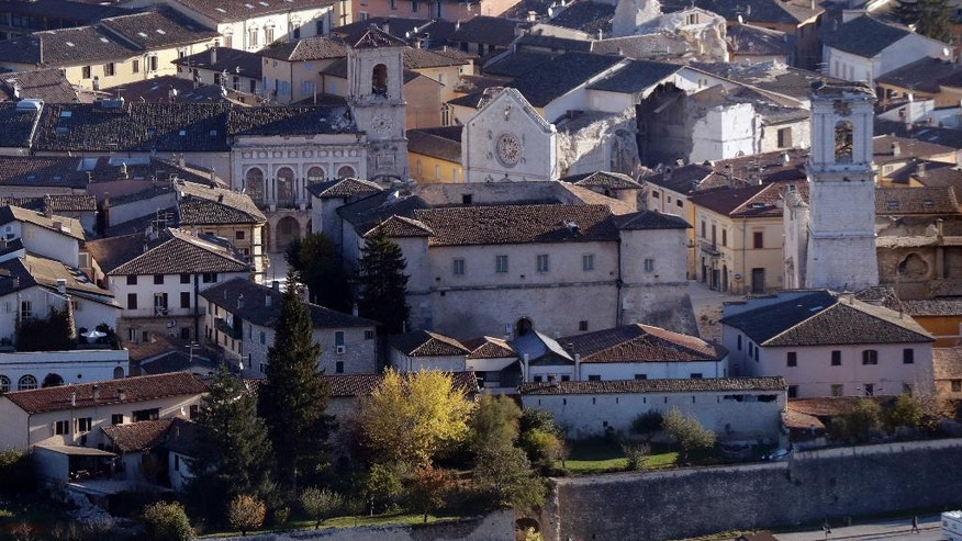 A general view shows a collapsed cathedral in Norcia, central Italy, Monday, Oct. 31, 2016. The third powerful earthquake to hit Italy in two months spared human life Sunday but struck at the nation's identity, destroying a Benedictine cathedral, a medieval tower and other beloved landmarks that had survived the earlier jolts across a mountainous region of small historic towns. (AP Photo/Gregorio Borgia)