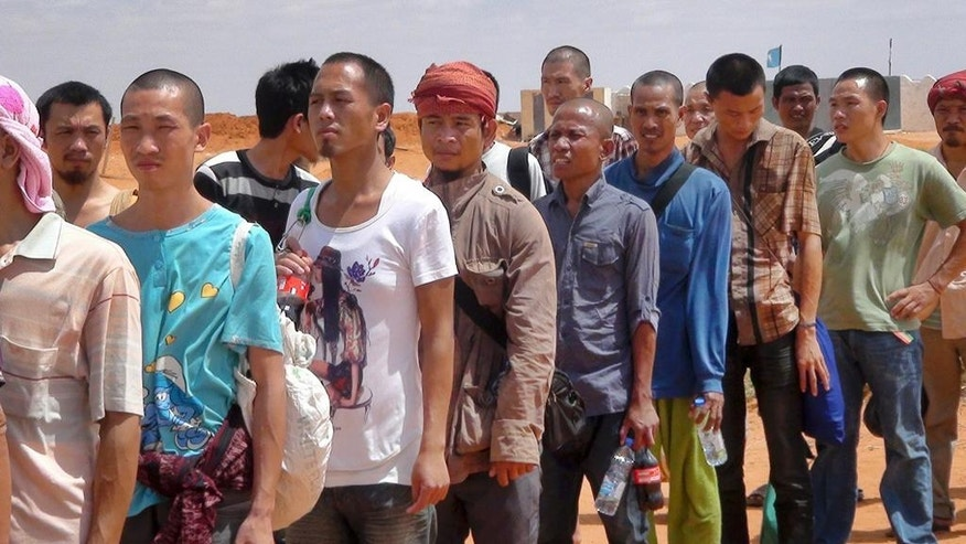 FILE - In this Oct. 23, 2016, file photo, sailors who had been held hostage by pirates for more than four years, queue to board an airplane after being released, in Galkayo, Somalia. Taiwan's government agencies at home and in three foreign capitals snubbed former legislator Tsai Cheng-yuan's pleas for help. Nervous donors who provided funds for a ransom demanded a money-back guarantee if the hostage wasn't released. Even after the money was paid, the man refused to return home unless 25 others held with him were also freed. The group was finally released Oct. 22, after more than four and a half years - the second-longest period hostages had ever spent in Somalia. (AP Photo/File)
