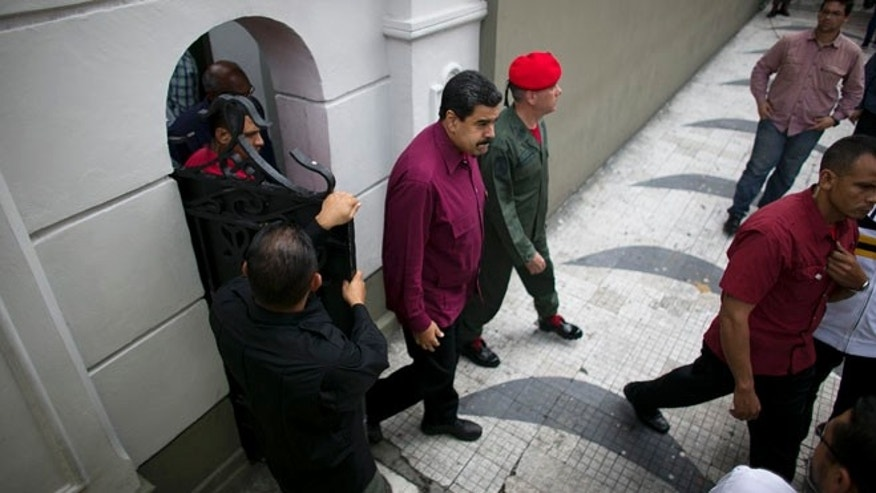 President Maduro exits an area of Miraflores presidential palace in Caracas, Venezuela, Friday, Oct. 28, 2016.
