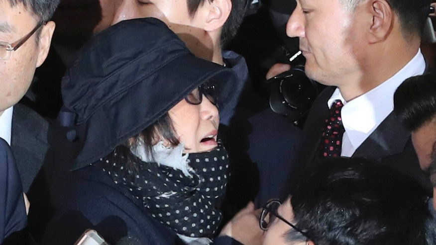 Oct. 31, 2016: Choi Soon-sil, center left, a cult leader's daughter with a decades-long connection to President Park Geun-hye, is surrounded by prosecutor's officers and media upon her arrival at the Seoul Central District Prosecutors' Office in Seoul, South Korea.
